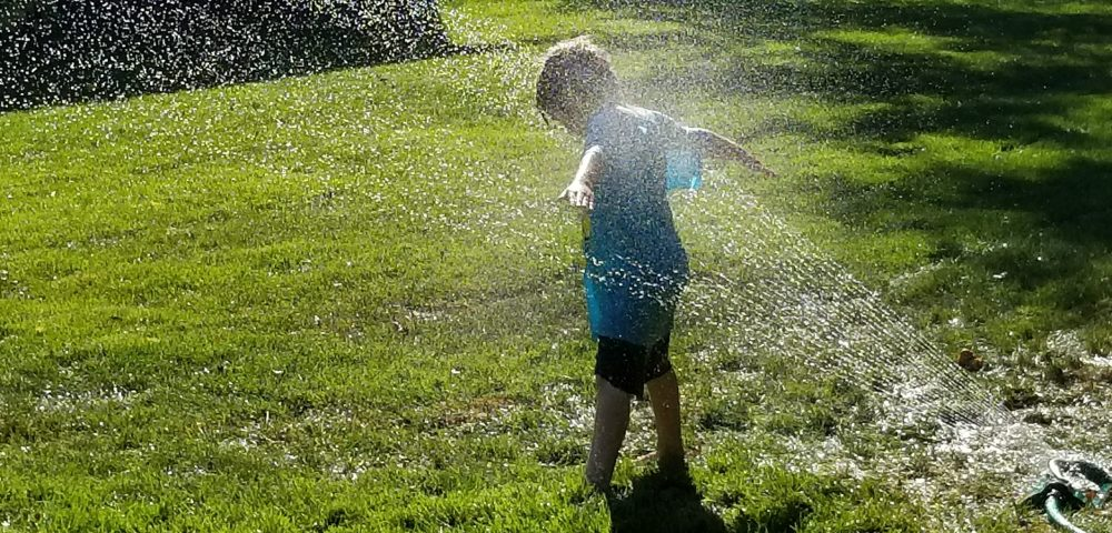 no boredom, child in sprinkler, mindfulness